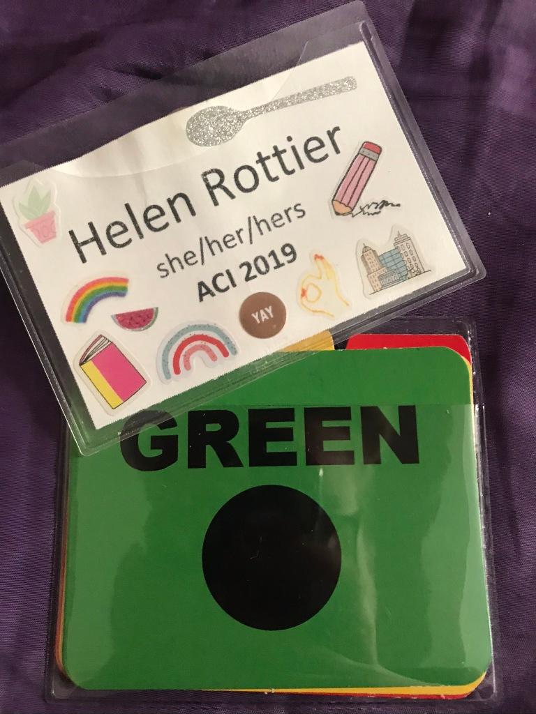 Helen's name badge and color communication badges from ACI